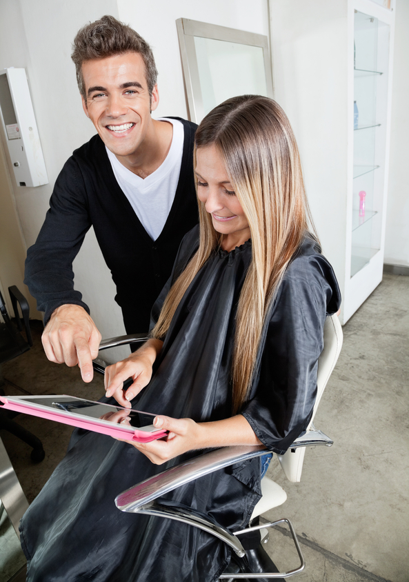 Hairdresser And Customer With Digital Tablet